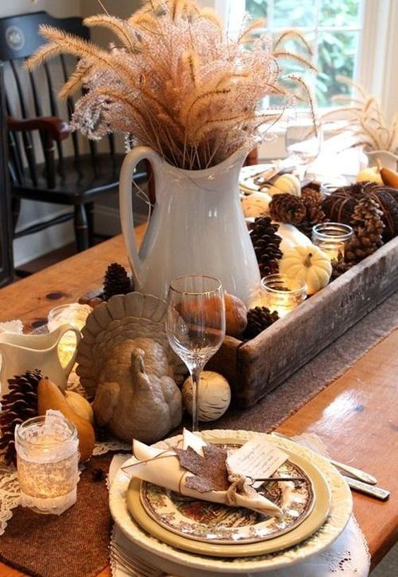 table arrangement for the center using pine cones and tiny pumpkins