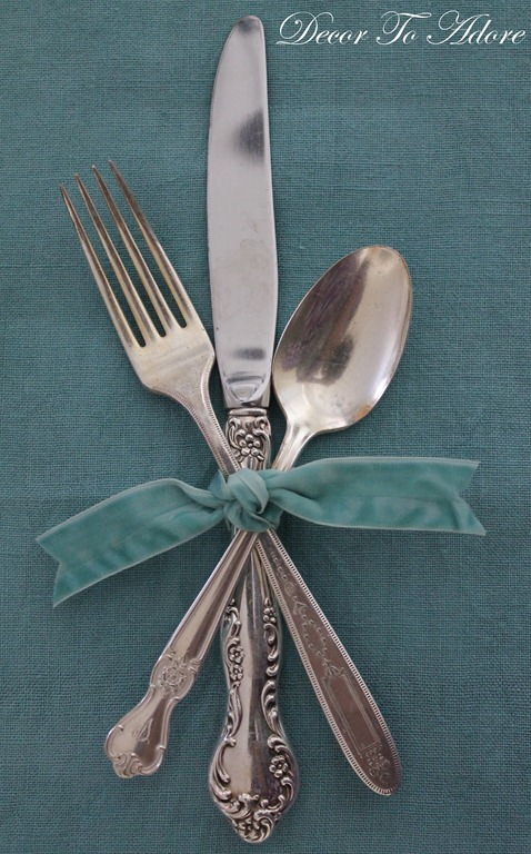 cutlery tied with ribbon