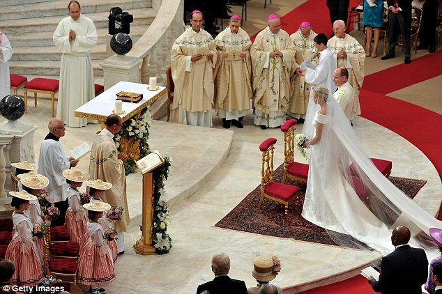 Religious ceremony: The Roman-Catholic ceremony follows the civil wedding which was held in the Throne Room of the Prince's Palace of Monaco yesterday