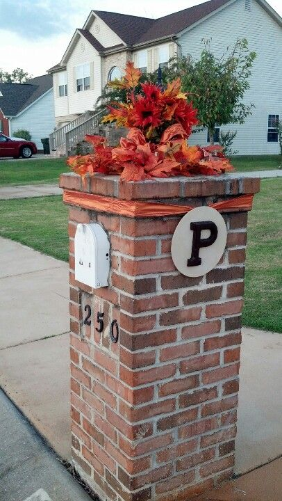 brick mailbox decorated for fall